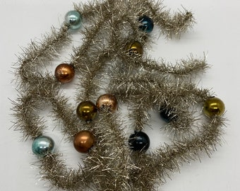"""Christmas Holiday Tinsel with plastic beads, 68"""" long, Antique Silver color tinsel, multicolor beads"""