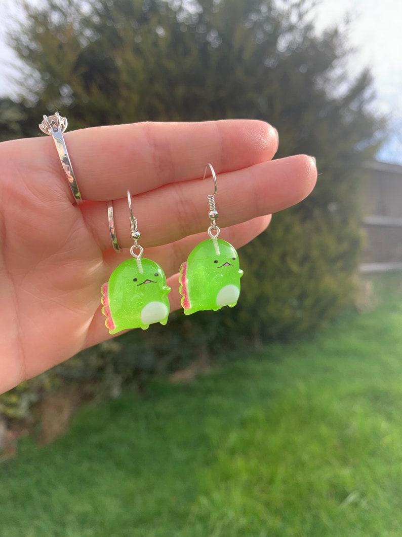 Green and pink weird wacky Dino Dinosaurs sweet cute gift present weird funny dangle drop earrings jewellery statement Knick knacks