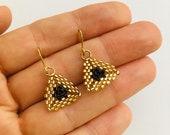Handmade seed bead drop earrings.