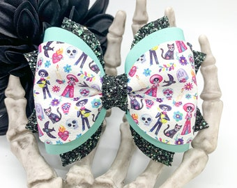 Coco inspired print faux leather bow