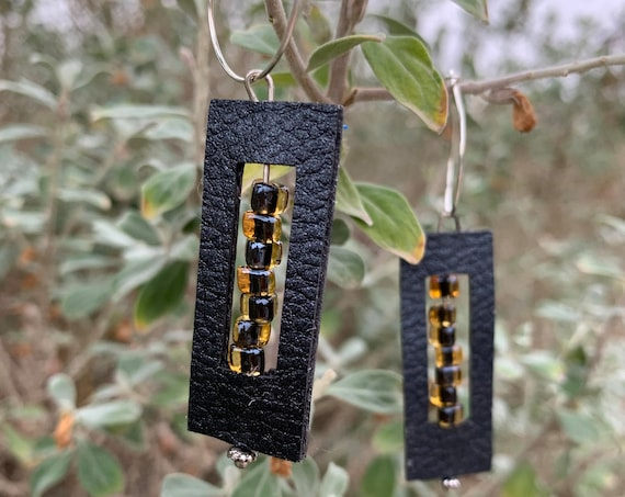 Black Leather amber & black inset glass beaded earrings, let the light shine!