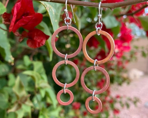 """Gorgeous 1.75/2.25"""" OA Graduated Copper Rings, glisten nicely in the light"""