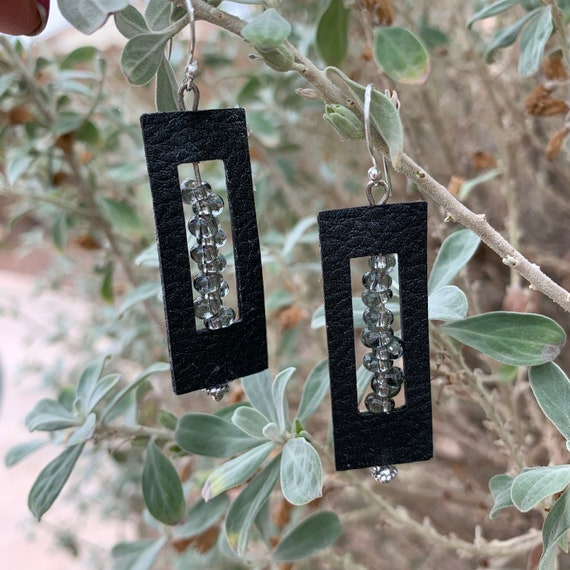 Black leather earrings with smoky black and glass beads that twirl & catch the light