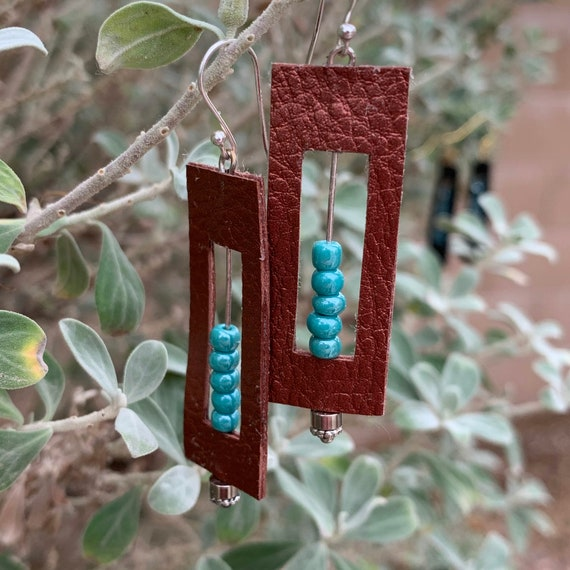 Bronze leather earrings with turquoise anchor beads, a bit of Southwest charm.
