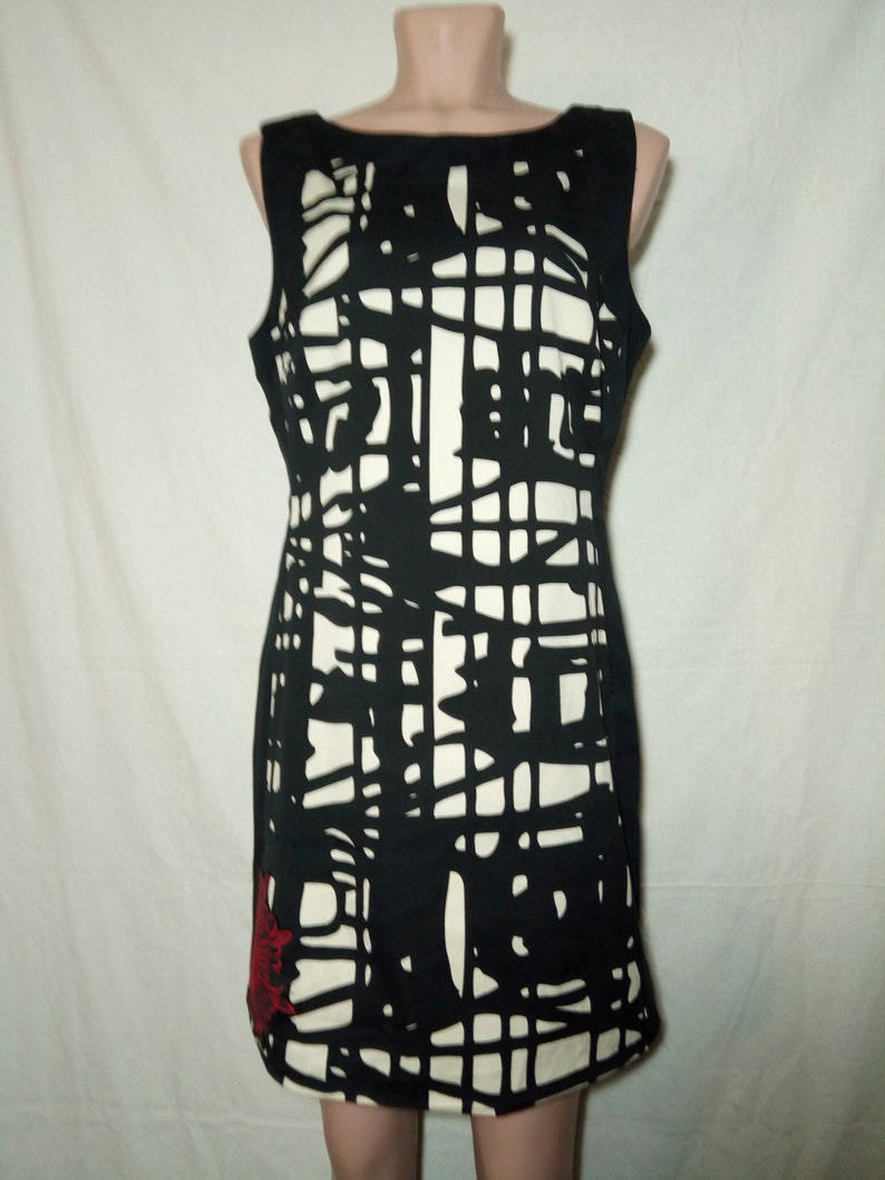 Desigual beautiful women cotton dress with embroidery.Lining with images.Size 42.
