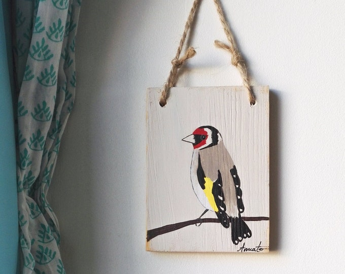 Elegant goldfinch paint table on recycled wood