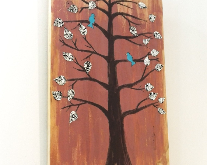 Table Tree and Birds adorned with metal sheets