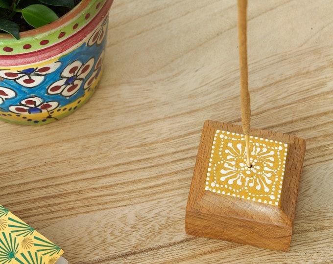Incense door painted rosette in reclaimed wood'