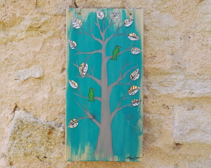 Table Tree and Birds adorned with recycled metal sheets