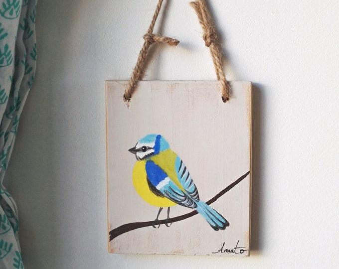 Mini painting blue paint on recycled wood