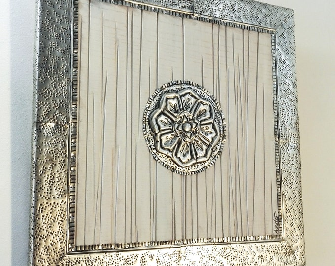 Oriental-inspired square board of recycled repulsed metal (board and cans)