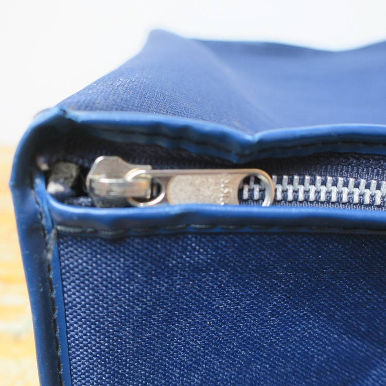 Old suitcasebag of blue cotton.