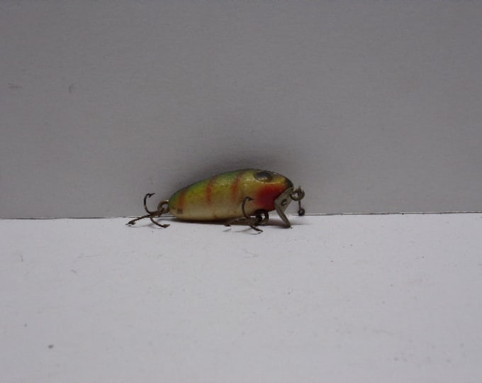 Vintage diving minnow fishing lure made of wood from 1940s 1950s