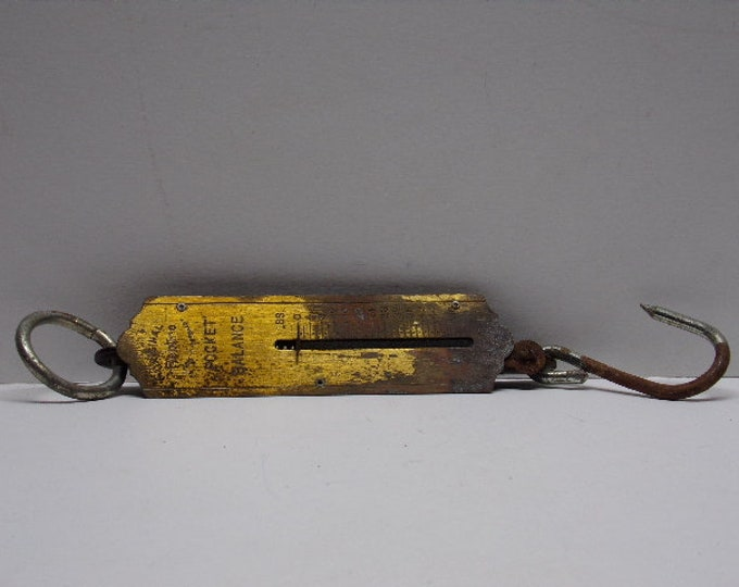 Vintage fishing scale rebure pocket balance from 1960s.