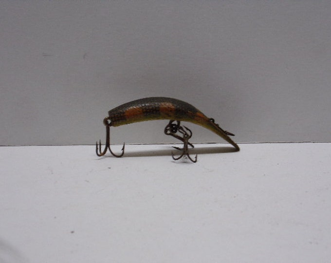 Vintage flatfish fishing lure model x-4 from 1960s