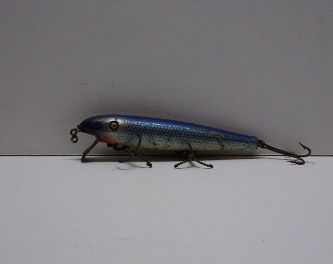 Vintage pflueger palomine minnow lure with glass eyes from 1940s 1950s