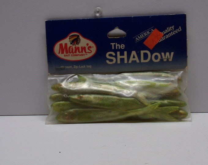 """Vintage manns the shadow rubber minnows 10 pack of 4""""  from 1980s."""