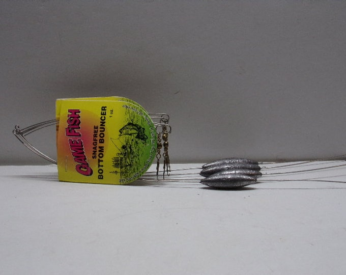 """Vintage game fish bottom bouncers 2   1 oz  2   1 1/2 oz  4 total size  10"""" from 1980s1990s."""