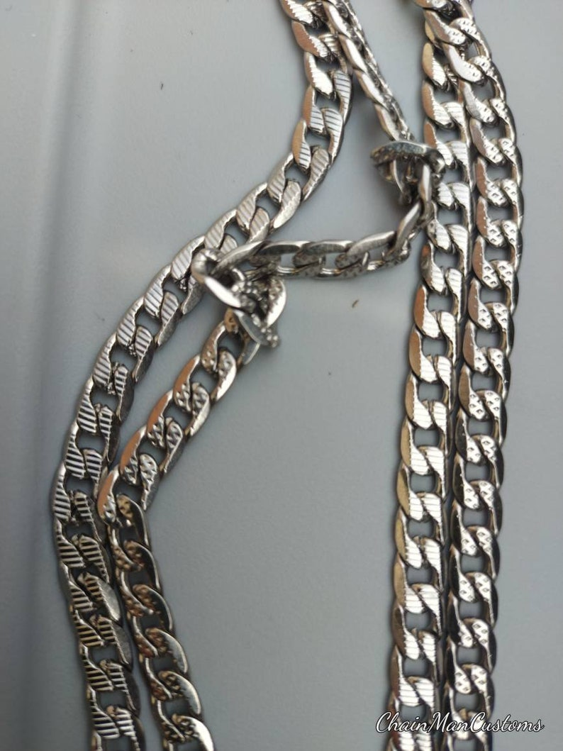 2 unique custom solid stainless steel tread chains