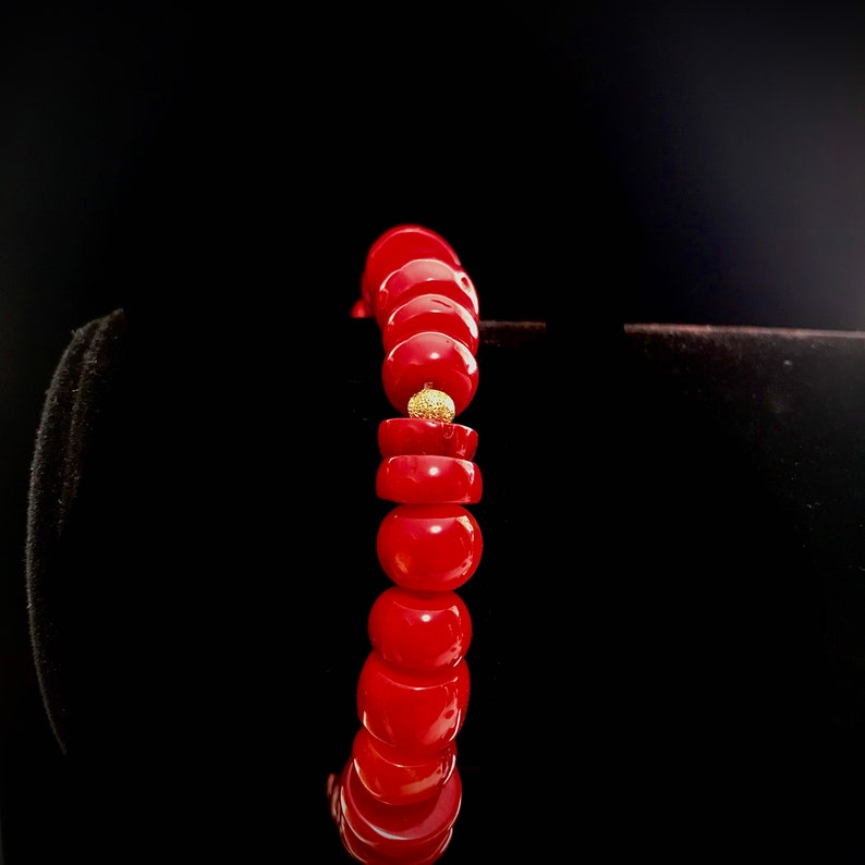 Stunning Red Bamboo Coral Stretch Bracelet with Exquisite Gold Plated CZ Micro Pav\u00e9 Round Wheel Spacers to add a touch of Sophistication
