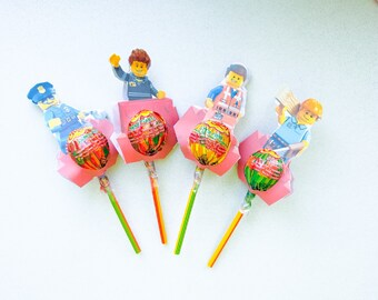 20 bags bearing confetti or lego-themed candy in cotton