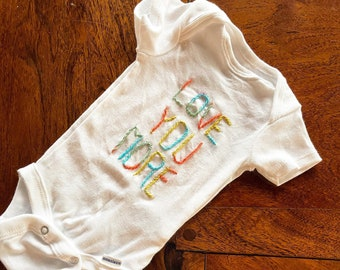 """Embroidered """"love you more"""" baby bodysuit"""