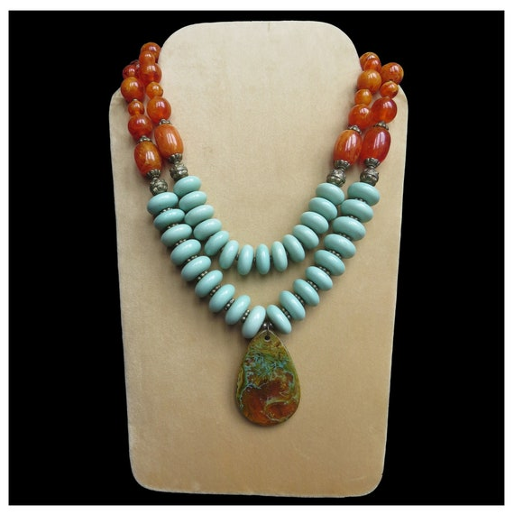 Handcrafted resin pendant with  glass beaded necklace