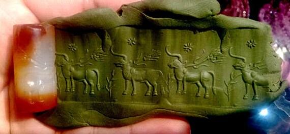 Ancient Mesopotamia intaglio orange agate roll bea