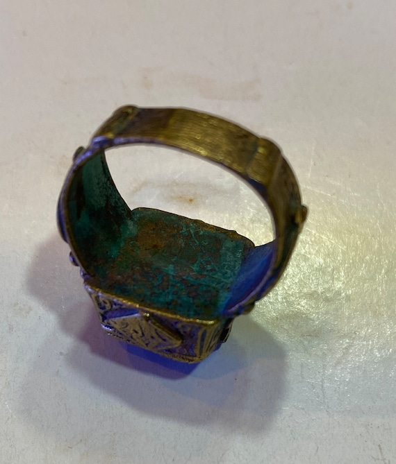 Handmade brass ring from Afghani with orange glass