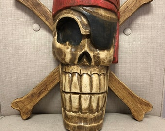 Wood carving pirate skull and crossbones