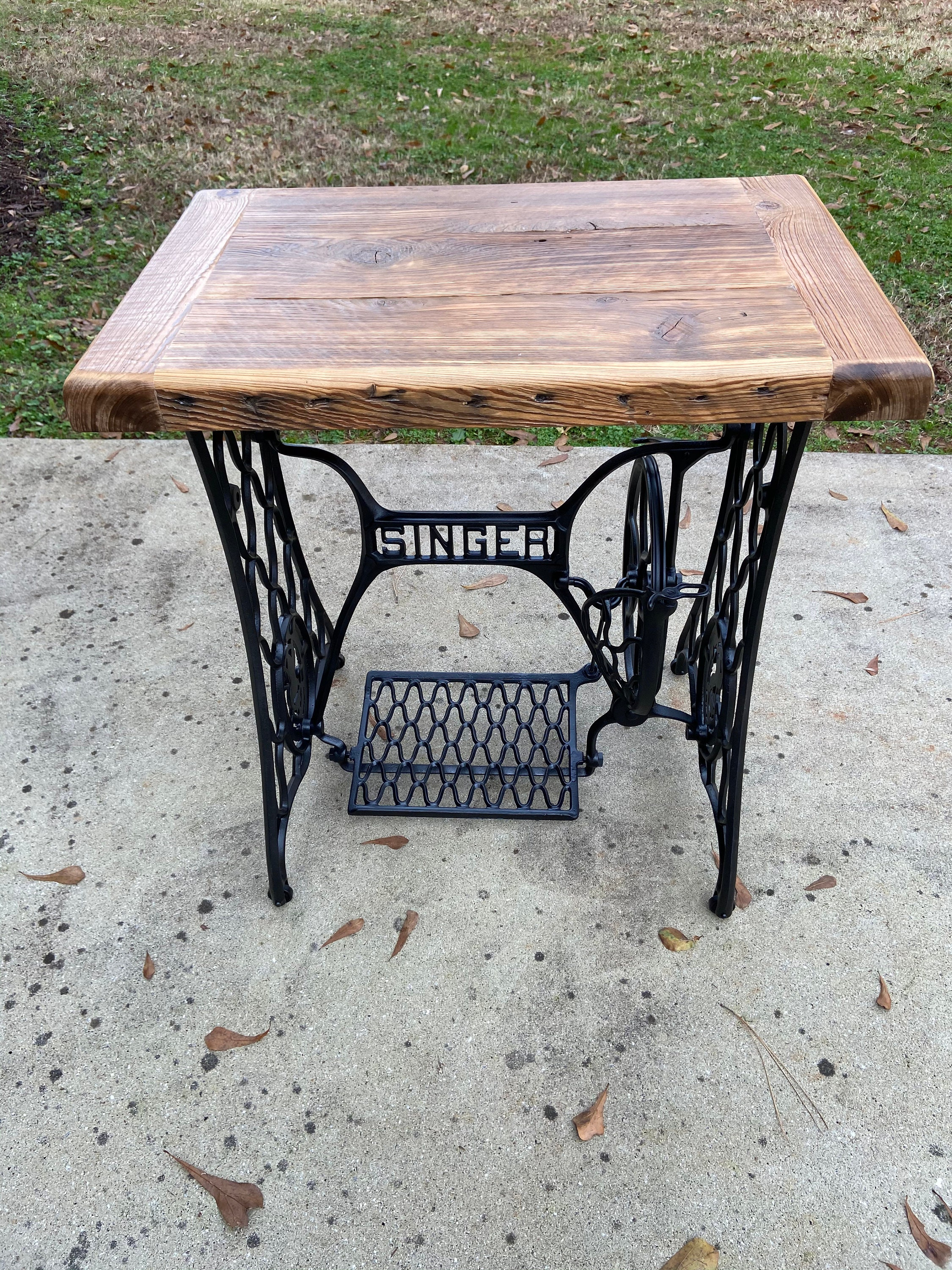 Early 1900's singer sewing machine with reclaimed cypress table top for sale