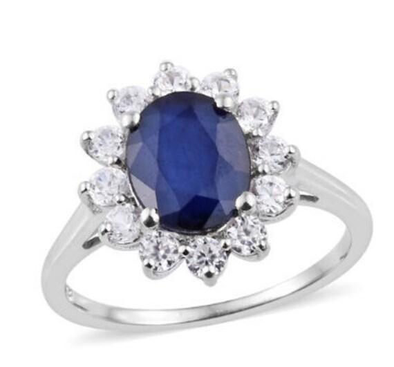 Princess Diana – 4ct Blue Sapphire & Natural Cambo