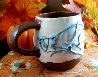 Ceramic mug rustic slip trailed design 10 ounces