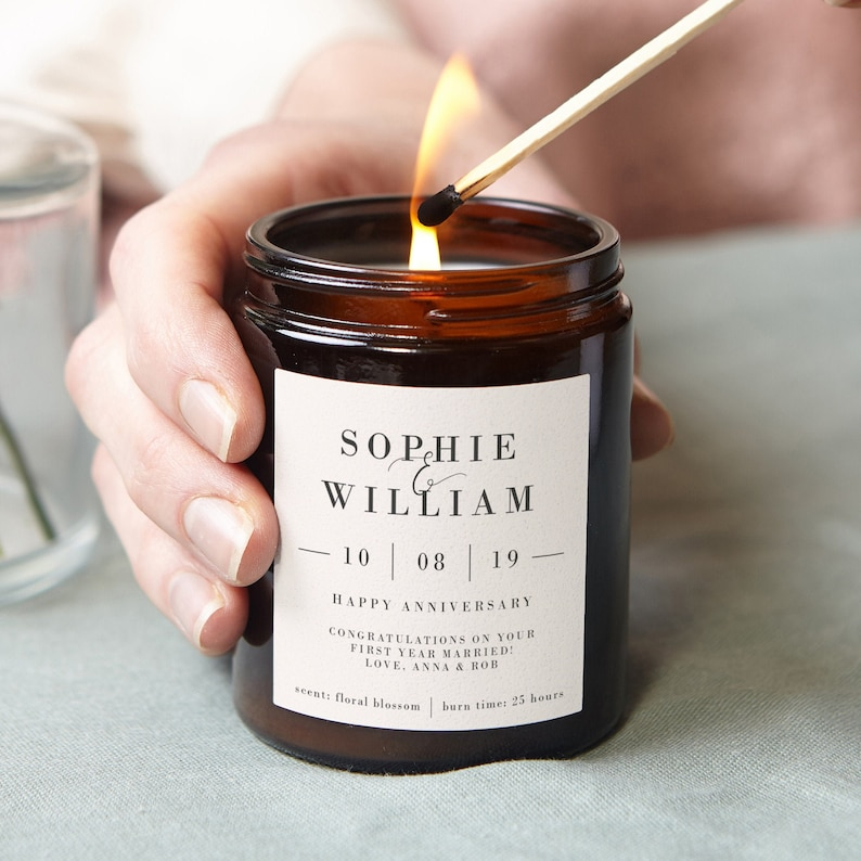 One of the best romantic gifts for your first anniversary is a love candle. A special candle with your couple's name on its label is meaningful and sweet. Every time it is burned, it'll warm her and bring her happiness.