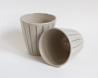 Minimal unique handmade/ handthrown stoneware ceramic cup/beaker with modern line detail and shiny transparent glaze