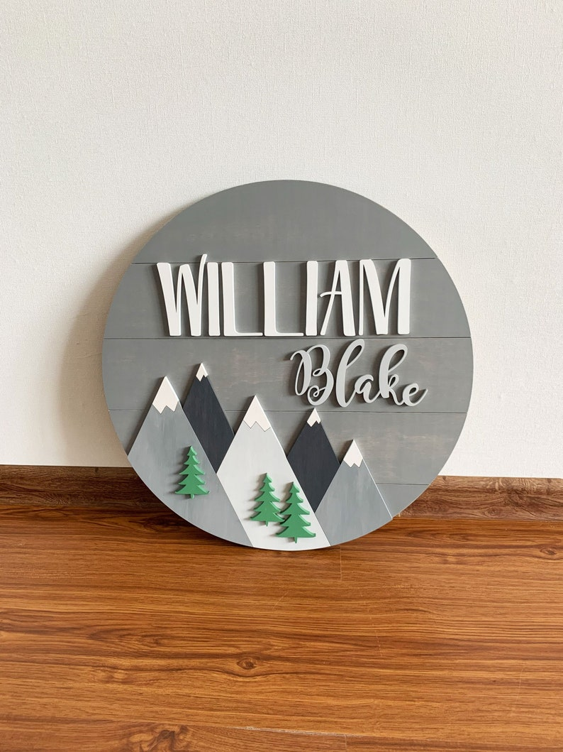 Mountains nursery wood baby name sign Round boy name sign for nursery Woodland kids bedroom Adventure room decor Personalised Door Plaque