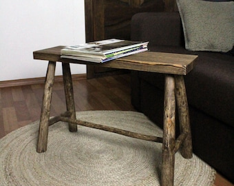 Handmade wooden bench. From natural trunks. Wooden bench. Bench of a rural house. Rustic. Rustic wooden seat. Home decor.  Primitive bench