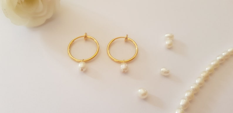 clip system earrings: earrings creoles with un pierced ear clips gilded with fine gold and fresh water pearl