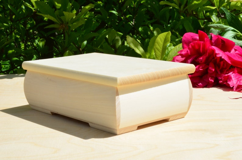 A jewelry box. Linen material trimmed with cotton lace Personalized wooden box for wedding rings The natural color of pine