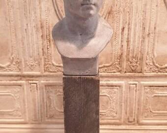 Miniature Emperor Caesar plaster bust.
