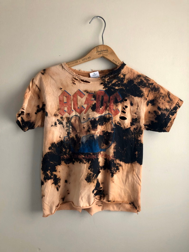 Bleached and tattered ACDC tour shirt size L but sized like a S