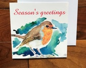 Christmas robin greeting card designed by British artist