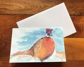 Pheasant in snow Christmas card by British artist