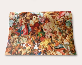 Lovingly designed gift wrapping paper for the Christmas season, angel, Santa Claus, glossy pictures