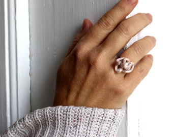 White ring made of papier-mâché for women