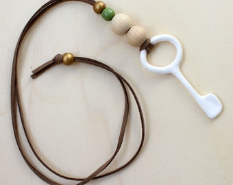 Necklace with white key in paper mache and wooden beads