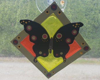 Butterfly resin faux stained glass window decoration, lime, red, yellow and black. They look beautiful on your lamp shades as well!