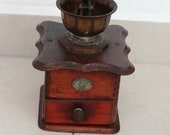 Former coffee mill, wood and cast iron, by Fabrik Marke K - M, old model at the beginning of the 19th century for collectors, origin in Germany