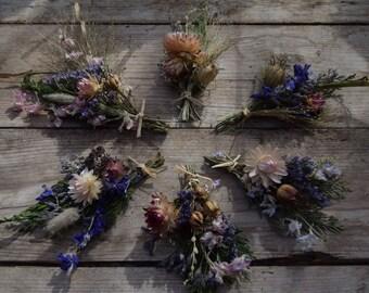 Six mini dried flower posies tied with raffia