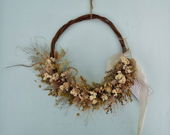 Winter garden. Pretty dried flower wreath in natural shades.